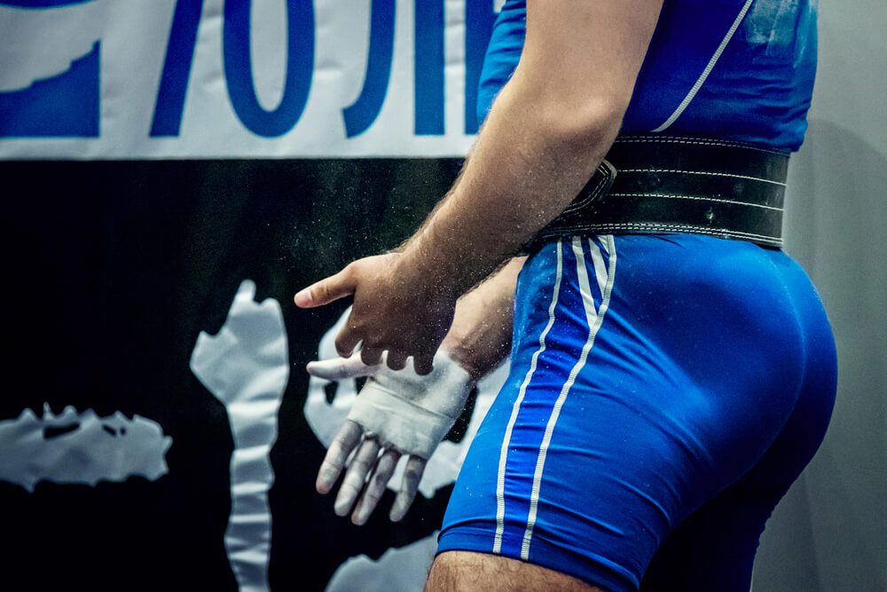 Powerlifter wearing singlet and belt